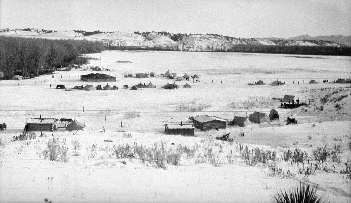 Log buildings and tents in winter, ca. 1922-1935. MS 165 Thomas B. Marquis Collection. PN.165.2.158