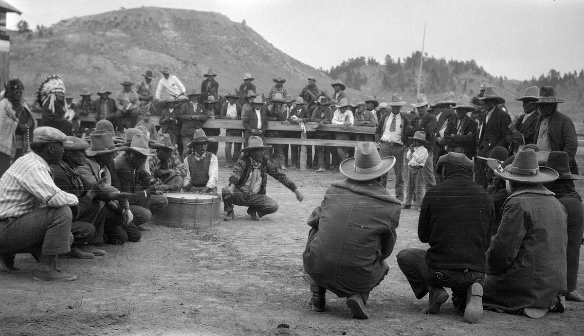 Cheyenne men and Crow men playing hand-game against each other at Cheyenne Fair in Lame Deer, Montana, 1928. MS 165 Thomas B. Marquis Collection. PN.165.1.32