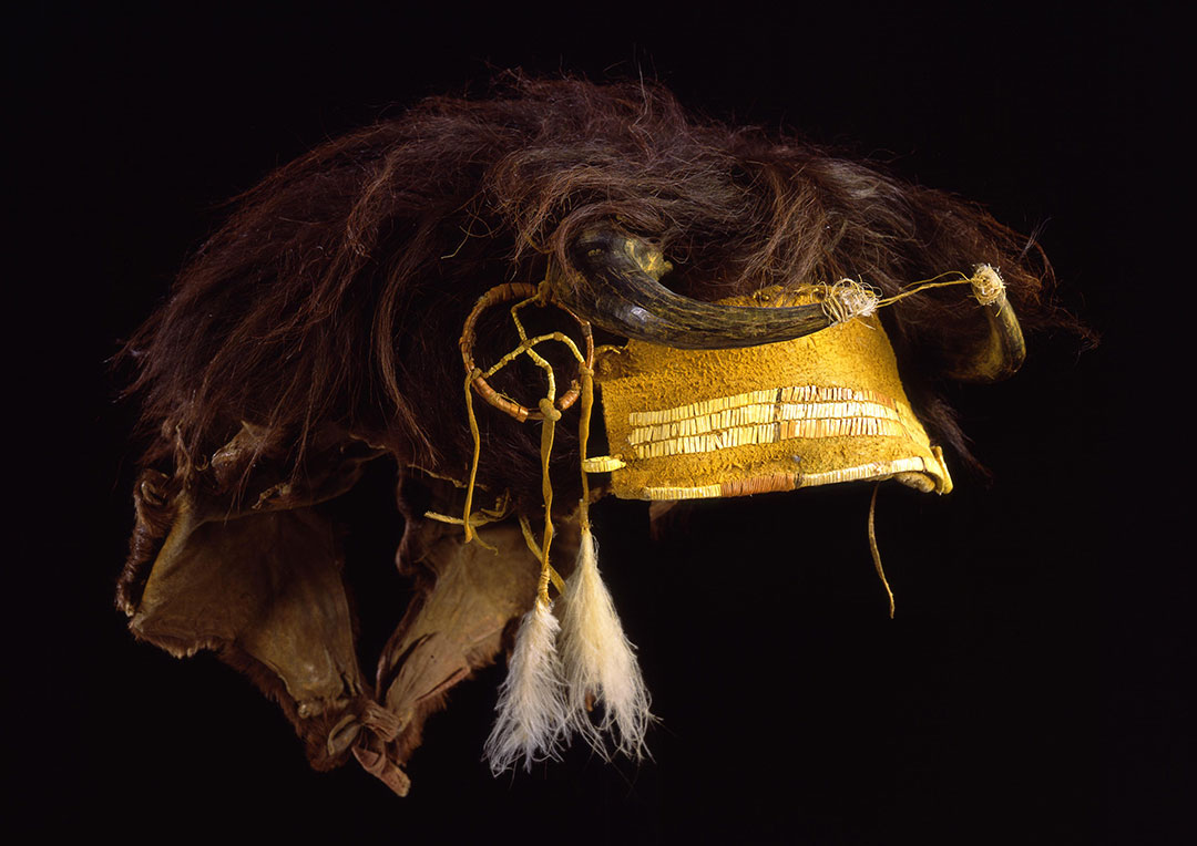 Buffalo Society headdress, ca. 1880. Buffalo skin, buffalo horn, feathers, sinew, porcupine quills. Chandler-Pohrt Collection, Gift of Mr. William D. Weiss. NA.203.358