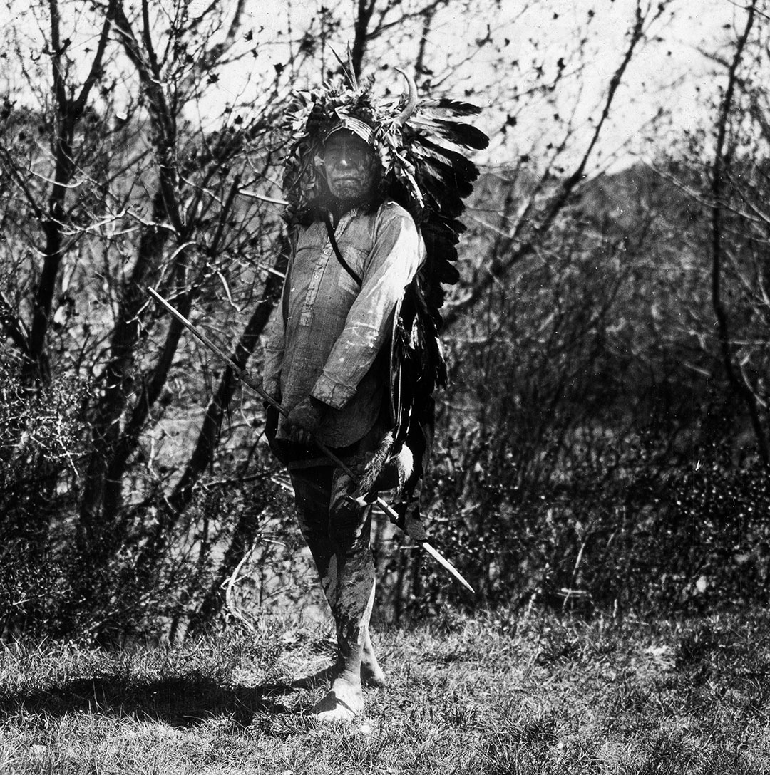 Crow man carrying lance, ca. 1903–1925. MS 95 William A. Petzoldt Lantern Slide Collection. LS.95.377