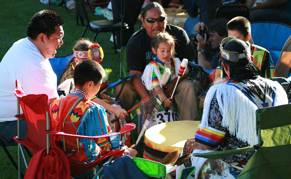 Multi-generational drum group at the 2010 Plains Indian Museum Powwow.