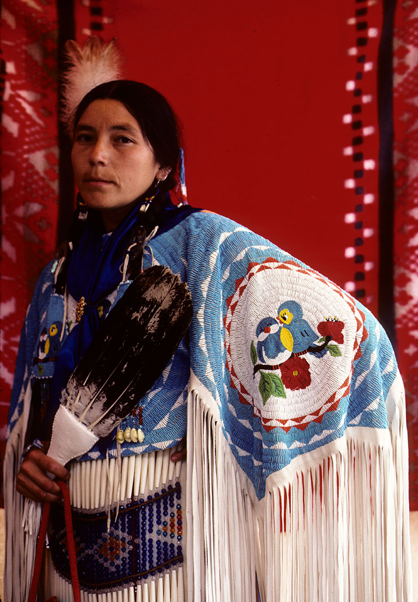 Women displaying detailed beadwork on her shawl. Ken Blackbird photograph. MS 426 Ken Blackbird Collection. KB.034