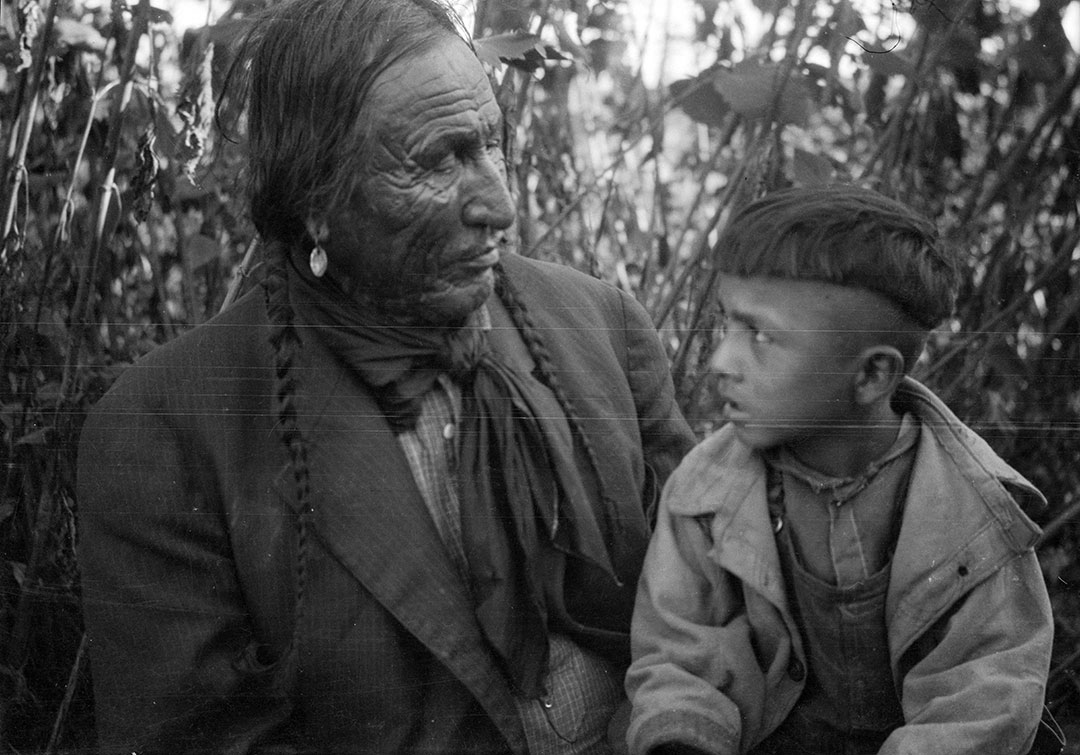 Elder sitting with boy, ca. 1922–1935. MS 165 Thomas B. Marquis Collection. PN.165.1.47