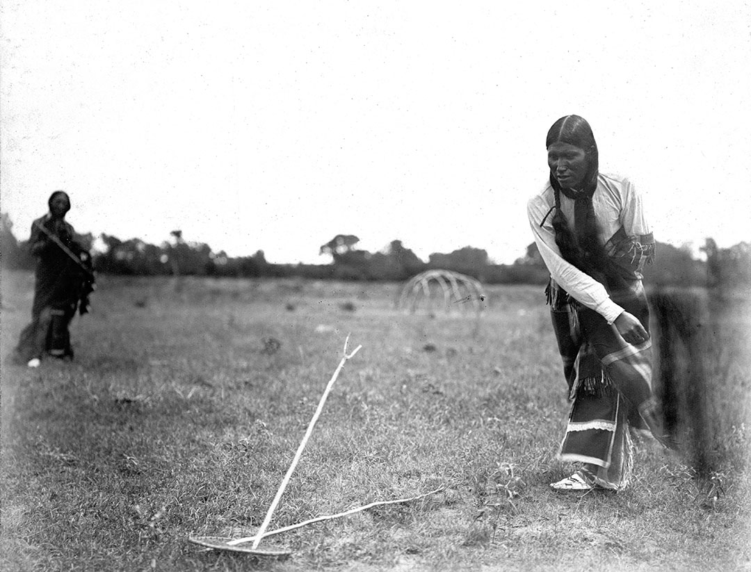 Playing hochtsim in Spotted Horse's camp, 1902. Southern Cheyenne. MS 37 Elizabeth C. Grinnell Collection. P.37.1.14
