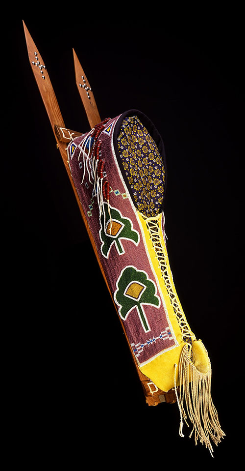 Cradle. Vanessa Paukeigope Jennings, Kiowa and Apache, Fort Cobb, Oklahoma, 1996. Tanned Deerskin, rawhide, glass beads, wood, cotton cloth, metal, and pigments. Museum purchase with funds provided by the Pilot Foundation and Arthur Amiotte. NA.111.59