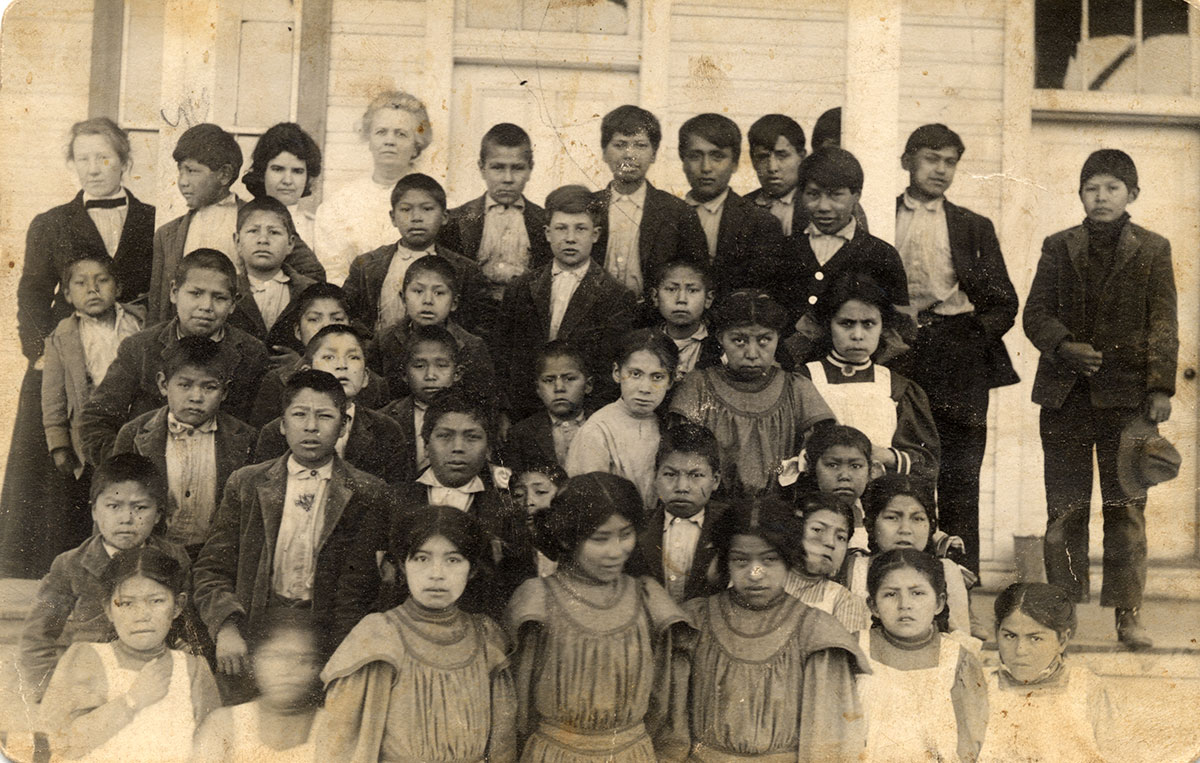 Teachers with Nez Perce students in western clothing, Fort Lapwai, Idaho, ca. 1905–1915. MS 320 Paul Dyck Plains Indian Buffalo Culture Collection. P.320.281