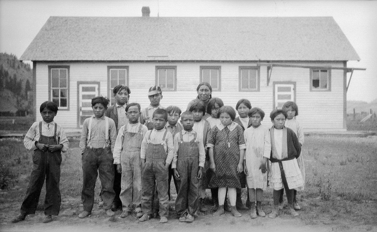 Schoolchildren outside their classroom, Lame Deer, Montana, 1926. MS 165 Thomas Marquis Native American Nitrate Negative Collection. PN.165.2.130