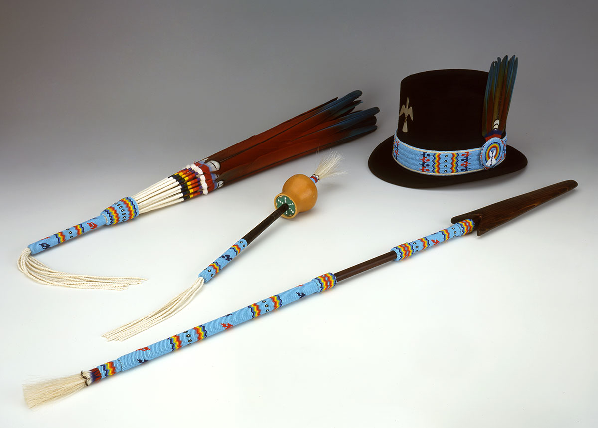 Native American Church set, 1998. Made by Emil Her Many Horses, Oglala Sioux. Feathers, glass beads, deer hide, metal, string. Gift of the Pilot Foundation. NA.502.215.1, .3, .4, and .5