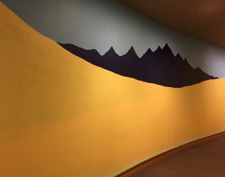 The background of the mural, begun by artist Sarah Shearer, that Family Fun Day participants can help complete on November 17 at the Buffalo Bill Center of the West.