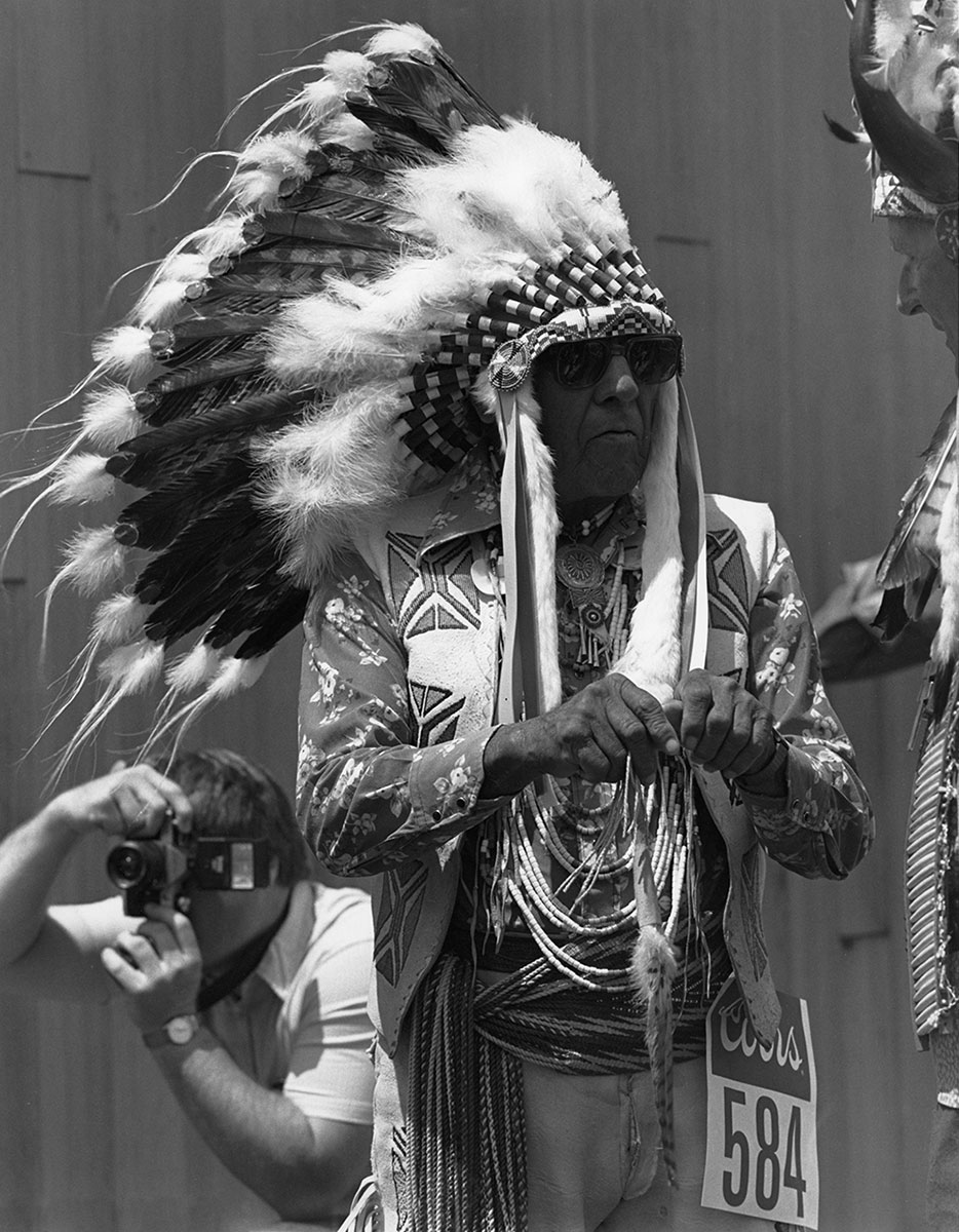 Joe Medicine Crow, Crow tribal elder, at the Plains Indian Museum Powwow, June 1987. MS 243 James Bama Collection. P.243.2
