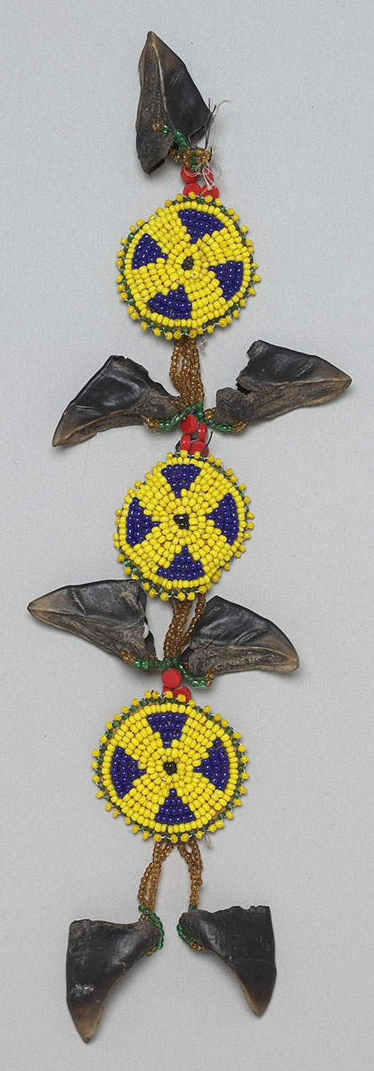 Tipi ornament, Northern Cheyenne. Leather, beads, dew claws. NA.302.105