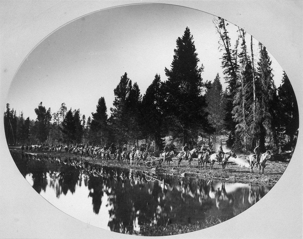 The Hayden party, roughly thirty in number, at Mirror Lake, the divide between the Yellowstone and the Lamar Rivers. Hayden is the second from the right behind his field manager James Stevenson. The Hayden Survey was a major effort to bring home the reality of the Yellowstone basin. WHJ-A.055