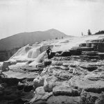 Hayden was certain that Jackson's photographs—like this one of artist Thomas Moran at White Mountain Hot Springs (today's Mammoth Hot Springs)—would sell Yellowstone. He simply needed an economical way to do it. WHJ-A.058