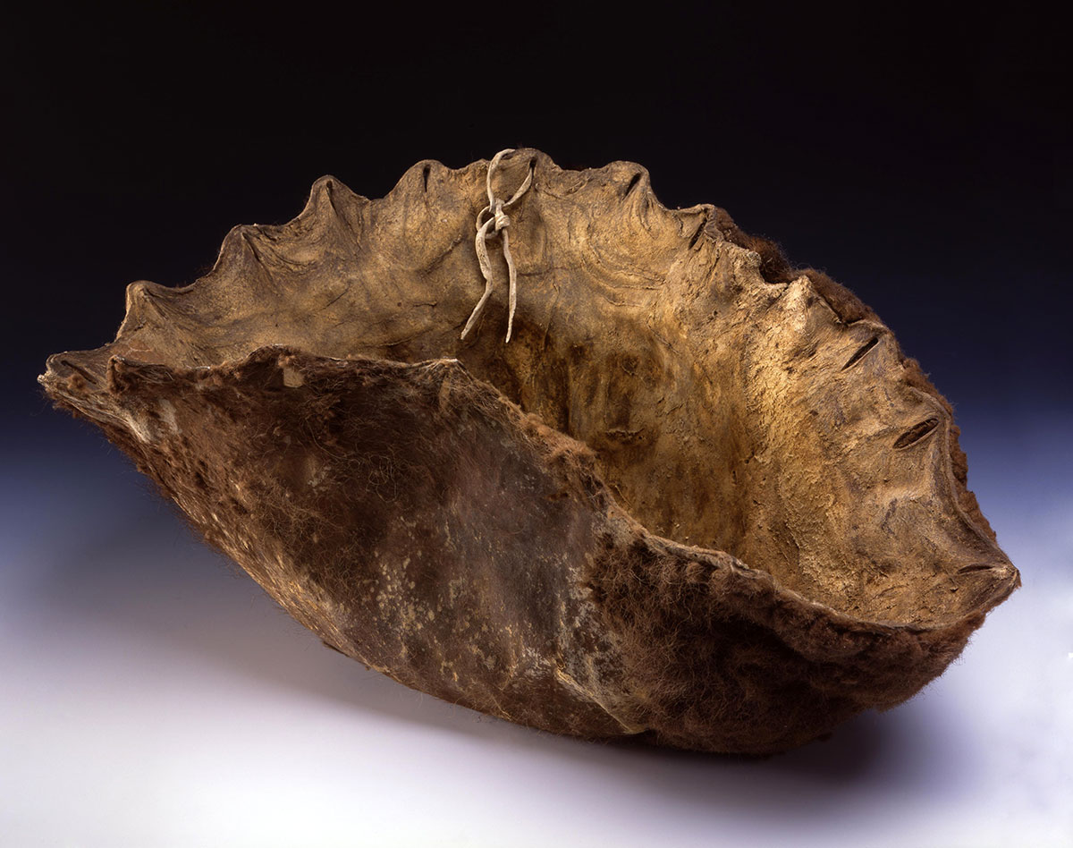 Buffalo hide bowl. Chandler-Pohrt Collection, Gift of Mr. William D. Weiss. NA.106.243