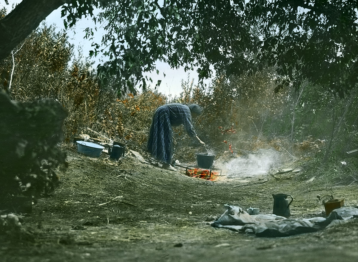 Crow woman cooking on campfire, ca. 1903-1925. MS 95 William A. Petzoldt Lantern Slide Collection. LS.95.319