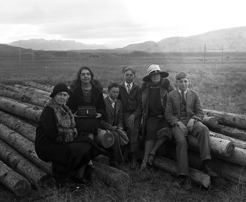 A Treasure from Our West: (L-R) Mary Jester Allen (1875-1960); Jane Garlow (1909-1987); George Walliker, the Garlow children's cousin; Bill Garlow (1913-1992); Geneva Garlow Walliker, Fred Garlow's sister and the Garlow children's aunt and caretaker; and Fred Garlow Jr. (1911-1985) sitting on logs at the construction site of the original Buffalo Bill Museum in downtown Cody, Wyoming. PN.228.146