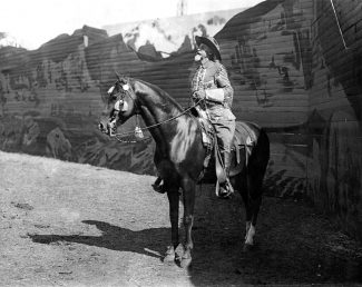 "Photograph, William F. ""Buffalo Bill"" Cody in the Wild West arena against backdrop,, ca. 1913. MS 6 William F. Cody Collection. P.69.740"