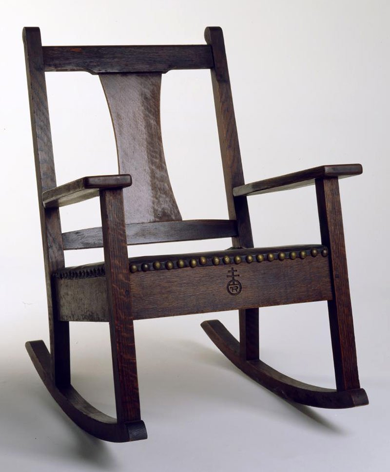Sharp's oak Roycroft rocking chair with a leather padded seat, ca. 1905. Height 30 inches. 19.00.92