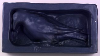 """Sharp's """"rook"""" sculpture by Rookwood Pottery, ca. 1902. Architectural clay, matte blue glaze, height 6 inches. 19.00.283"""