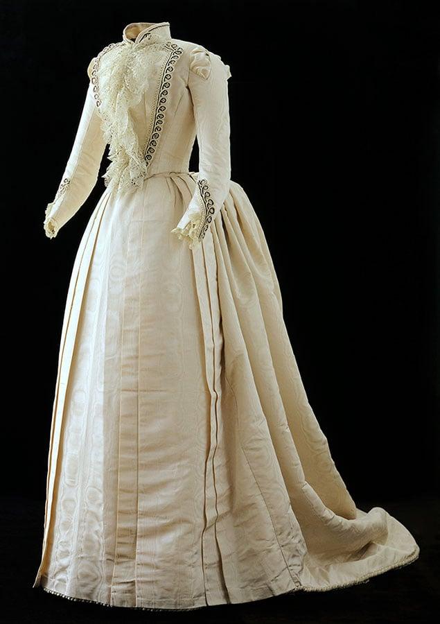 Arta Cody's ivory silk taffeta moiré dress from her wedding to Horton Boal in 1889. Gift of Mr. & Mrs. Robert F. Hayden. 1.69.2041