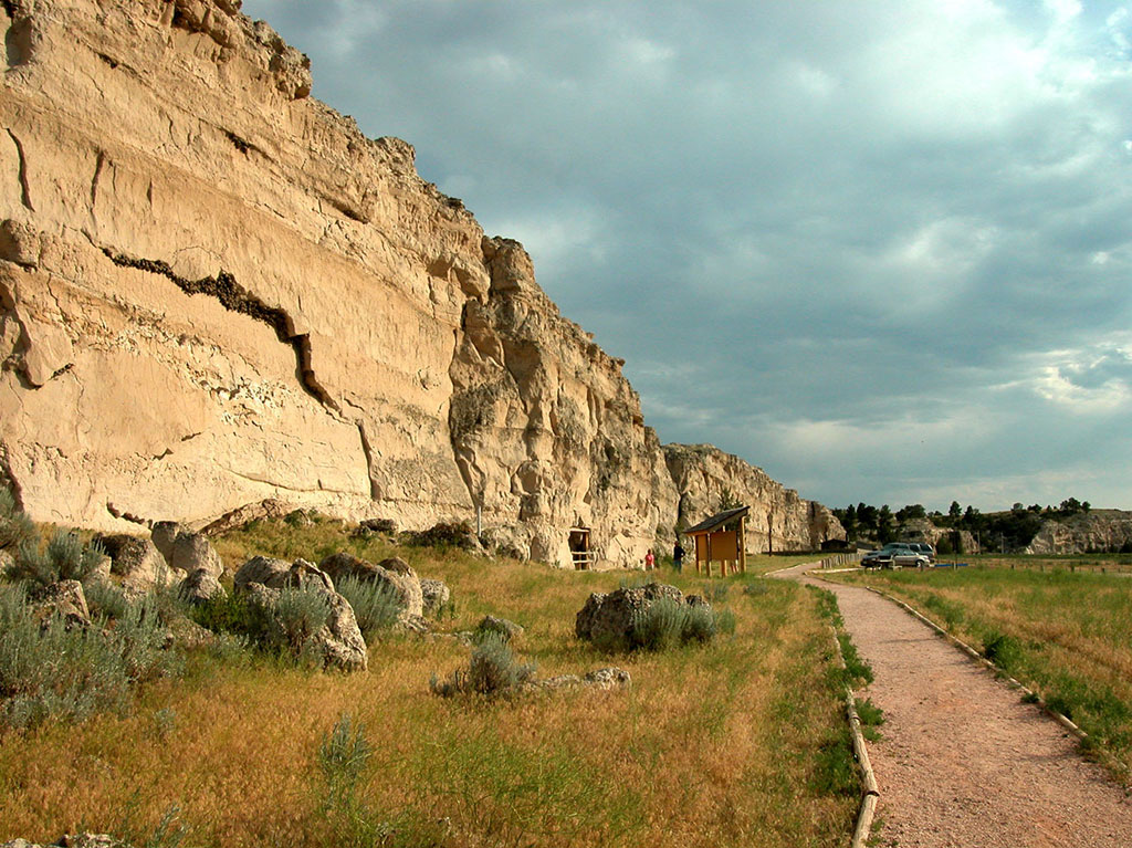 Register Cliff is one of the landmarks on the Oregon Trail. Located outside Guernsey, Wyoming, the cliff still bears the names of many pioneers who inscribed their names in the soft rock decades ago. NPS photo.