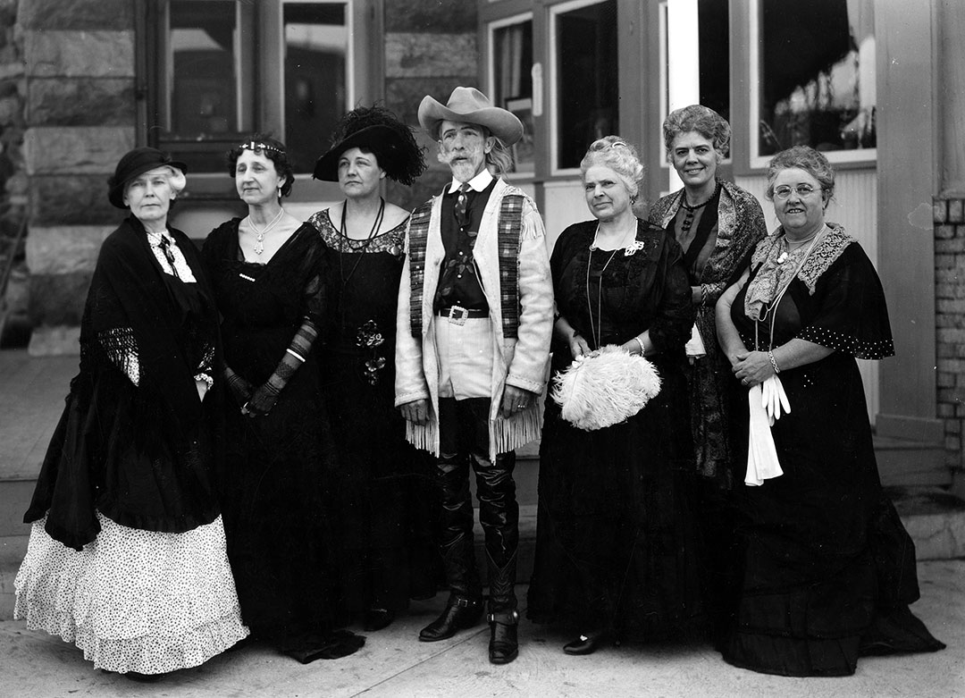 Buffalo Bill birthday party-goers in front of the Irma Hotel, ca. 1946. (L – R) Mary Jester Allen, Else Wiggenhorn, Mrs. Vogel (Sr.), Finley A. Goodman as Buffalo Bill, Josephine Goodman Thurston, Mrs. Ed P. Heald, Mrs. Ned Frost (Mary). Buffalo Bill Center of the West, Cody, Wyoming, USA. MS 6 William F. Cody Collection. P.6.1699