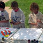 Kids enjoy a painting activity at a Buffalo Bill Center of the West Family Fun Day.