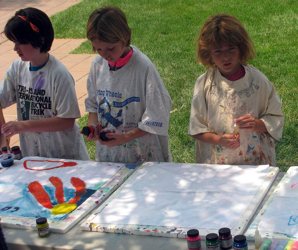 Kids enjoy a painting activity at a Buffalo Bill Center of the West Springfest Family Fun Day.