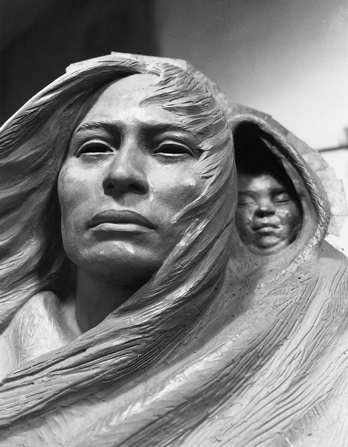 Detail of clay model of Sacajawea and baby.