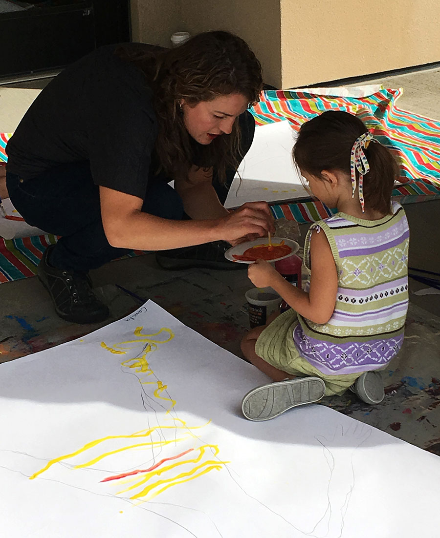 Instructor Sarah Shearer assists a Little Aspiring Artist – for kids 3–5 – July 23, 25, and 27, 2018