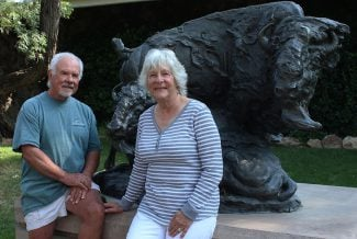 "Paul and Karen George in the Center's Braun Garden. T.D. Kelsey's ""Change of Seasons."" 2.95"