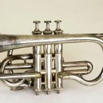 Cody Bell's cornet. Chicago Music Company, 1902. Gift in memory of William A. Bell and Leonard Cody Bell by Mrs. Frances Slattery Guilbert. 1.69.6106