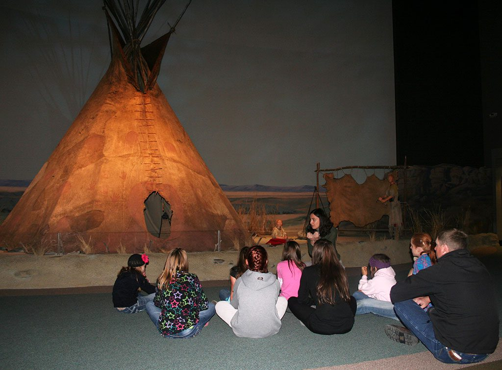 Educator Megan Smith with a MILES group in the Plains Indian Museum.