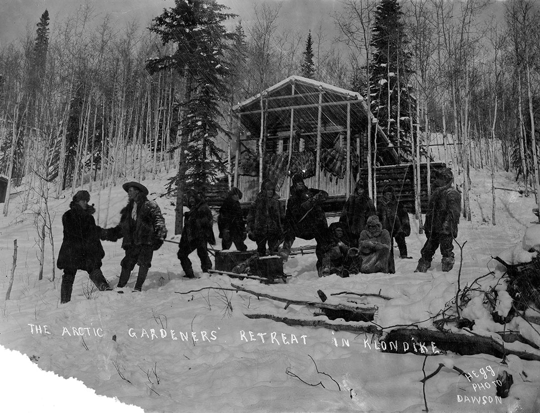 """Crawford's """"Arctic Gardeners' Retreat in Klondike,"""" ca. 1890s. Hegg Photo. Dawson, Yukon Territory, Canada. Inscription: For Captain Jack With The Best Wishes of J.A. Acklen. MS 322 John Wallace Crawford Collection. P.322.0186"""