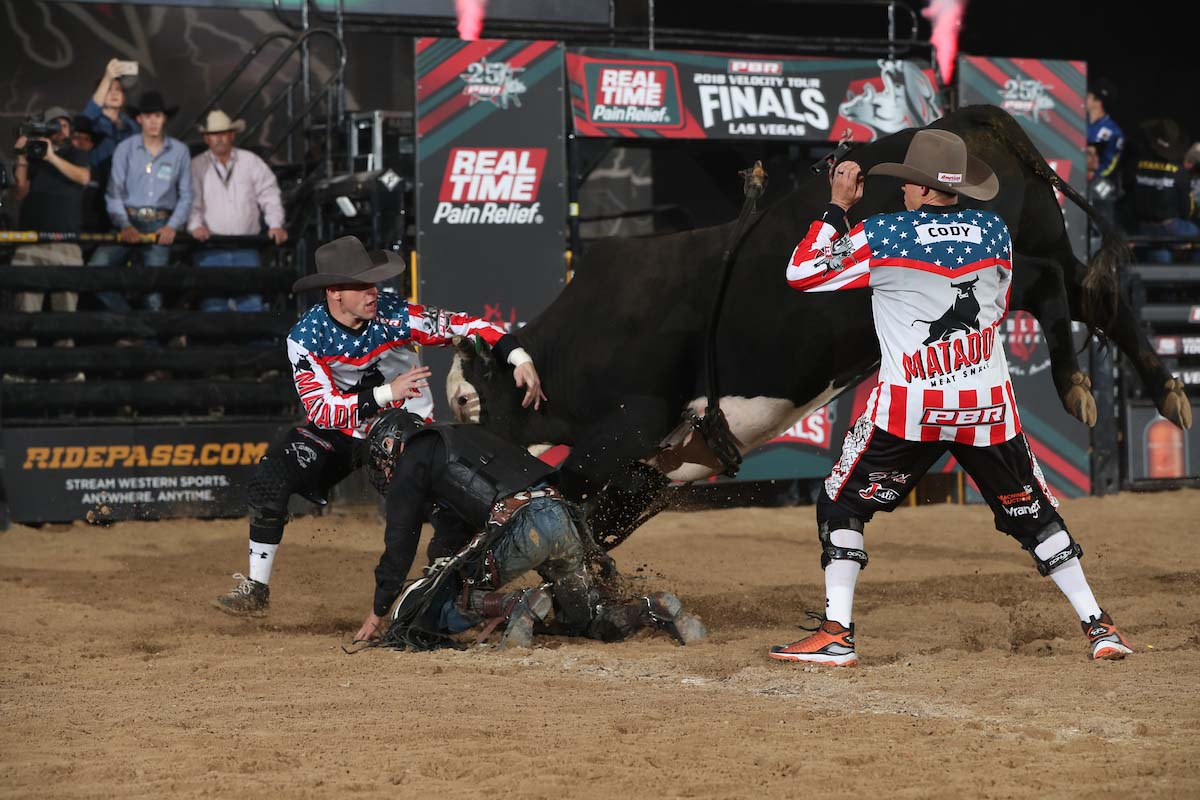 Bryan Titman rides RF Livestock's Bo Duke for 80 and Nate Jestes steps in during the first round of the Las Vegas, PBR Real Time Pain Relief Velocity Tour Finals. Photo by Andy Watson.
