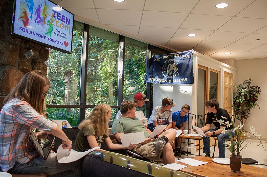 Admiring their hard work is the Center of the West Youth Advisory Board members, L – R, Paige Martinez, Daniel Deming, Julia Cook, Carter Schutzman, Colton Manchester, Logan Schutzman, and Jasper Crofts.