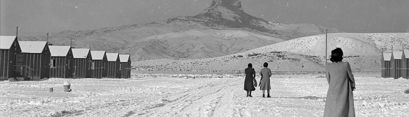 Japanese-American women walk to their barracks at Heart Mountain Relocation Center. MS 89 Jack Richard Photograph Collection, McCracken Research Library. PN.89.111.21238.3 (detail)