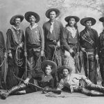 Young cowboys from Buffalo Bill's Wild West, 1886, posing with their guns and chaps. Original Buffalo Bill Museum collection. P.6.86