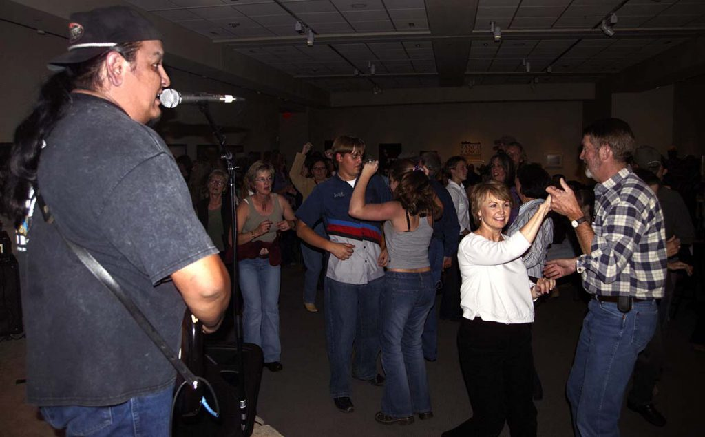 Concert-goers take to the floor to dance during the September 30, 2004, concert at the Center. Chris Gimmeson photo.
