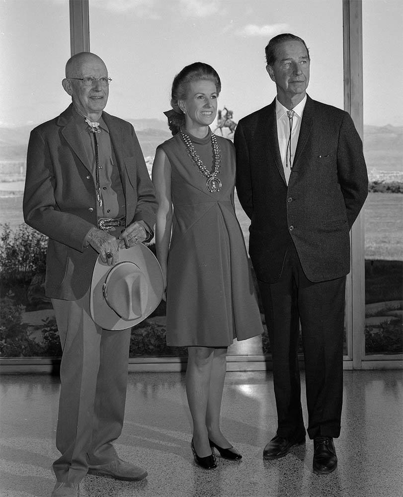 Fig. 10: Museum Director Harold McCracken (L) and Marylou and Cornelius Whitney in the Whitney Gallery of Western Art, September 15, 1968. MS 089 Jack Richard Photograph Collection, McCracken Research Library. PN.89.50.10158.11