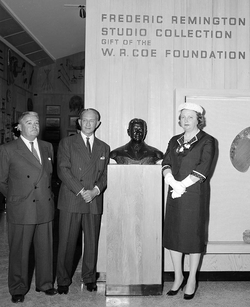 "(L–R) Henry Coe, Robert D. Coe, and Mrs. Henry ""Peg"" Coe, April 23–24, 1959, at the grand opening of the Whitney Gallery of Western Art, today's Whitney Western Art Museum. MS 089 Jack Richard Photograph Collection, McCracken Research Library. PN.89.23.3890.41"