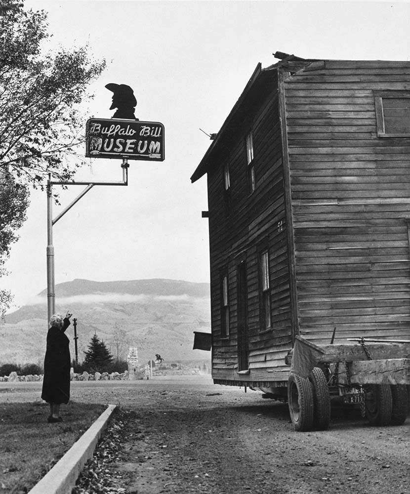 Fig. 3: Buffalo Bill's boyhood home arrives at the original Buffalo Bill Museum under the watchful eye of Curator Mary Jester Allen. MS 6 William F. Cody Collection, McCracken Research Library. P.69.1381