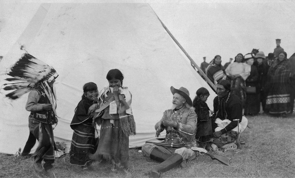 Buffalo Bill with Indian children at his Wild West, ca. 1915. MS6 William F. Cody Collection, McCracken Research Library. P.6.0243