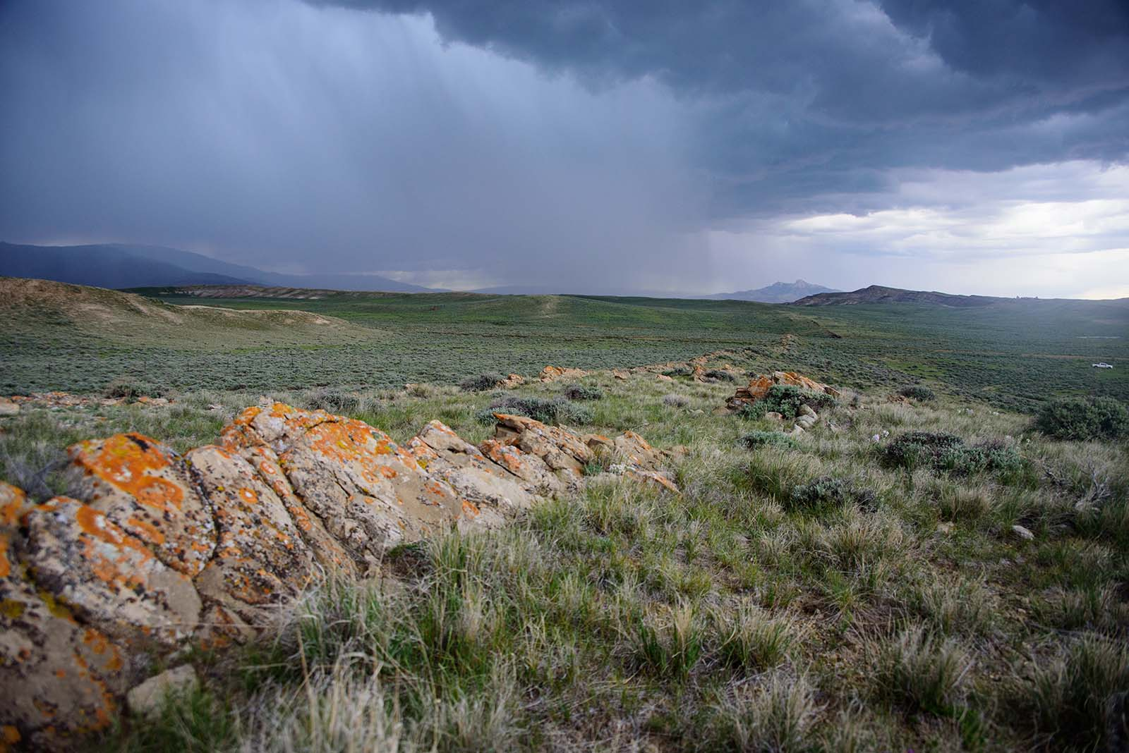 Rain clouds with Heart Mountain in distance. Moosejaw Bravo Photography.