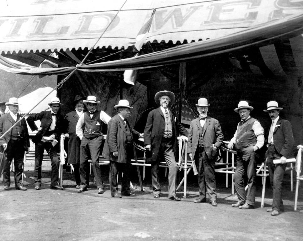 William F. Cody, James A. Bailey and other men at the entrance to the wild west show, ca. 1900. MS006 William F. Cody Collection. P.69.0986.