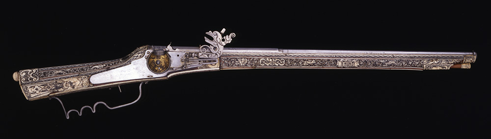 This German wheellock musket with carved ivory stock and barrel depicting human figures, floral scrolls, and animals dates to 1596. Gift of Olin Corporation, Winchester Arms Collection. 1988.8.1028