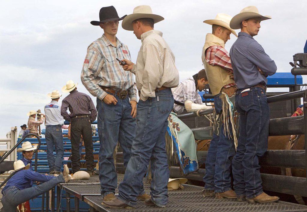Cowboys waiting on the catwalk at Stampede Rodeo, July 2009. MS 426 Ken Blackbird Collection. P.426.05380