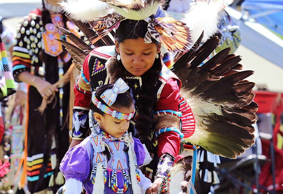Archuleta siblings, sister Taylor Archuleta 3 yrs and brother Darrian Archuleta 11 yrs, Pueblo/Southern Ute. Teen boy's traditional and tiny tot jingle dress dancers from Albuquerque, NM. ©2019 Photo by Frontier Fortitude.