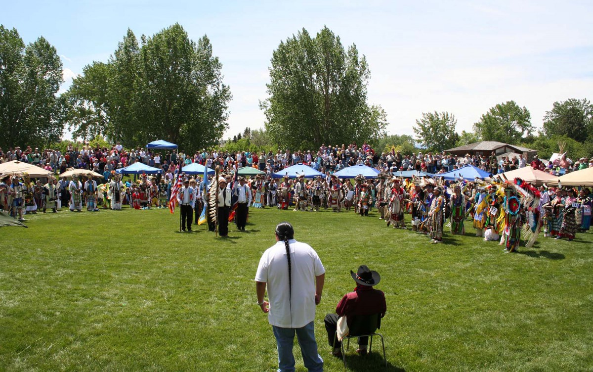 Joe Medicine Crow (seated) oversees the Grand Entry and presentation of the Color Guard at the 2011 Plains Indian Museum Powwow.