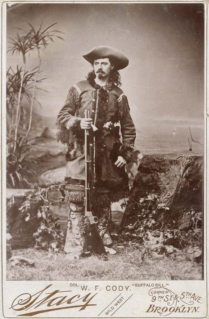 """hotograph, William F. """"Buffalo Bill"""" Cody in fringed buckskin with rifle, ca. 1870-1880. Studio portrait by Stacy. Buffalo Bill Center of the West, Cody, Wyoming, USA. MS 6 William F. Cody Collection, McCracken Research Library. P.6.0156"""
